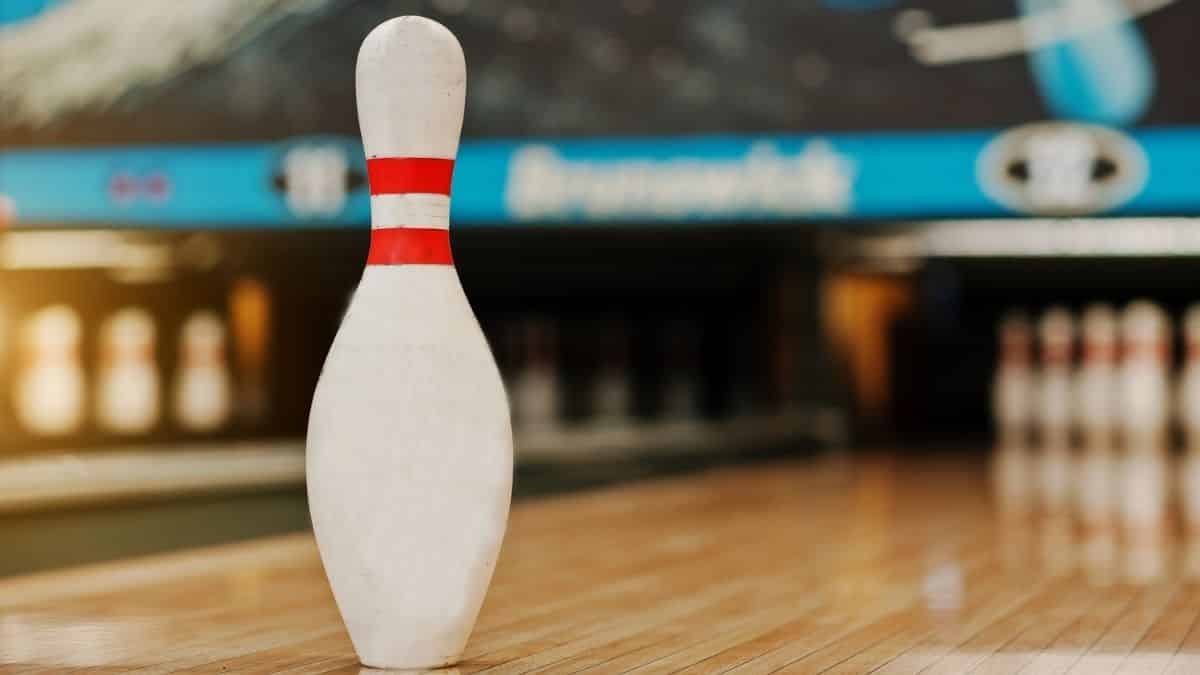 a single bowling pin in a bowling alley