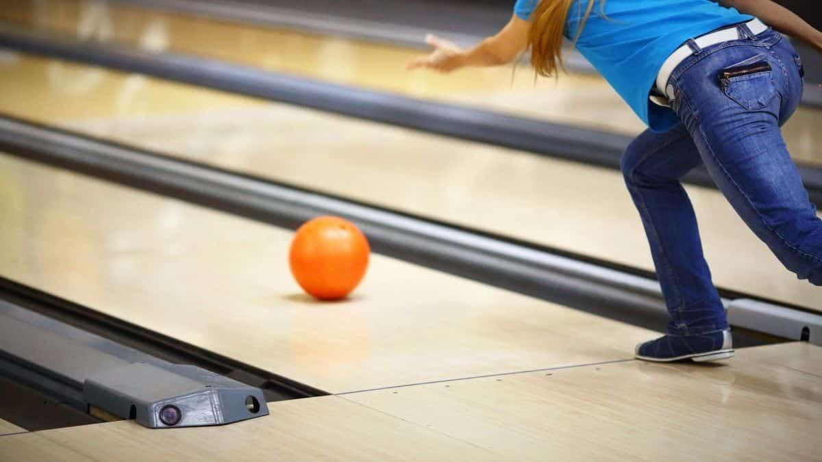 woman wearing blue shirt playing bowling