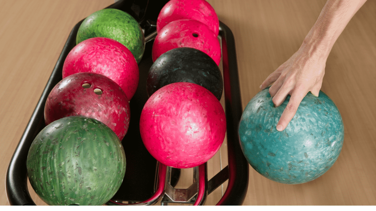 player holding a bowling ball