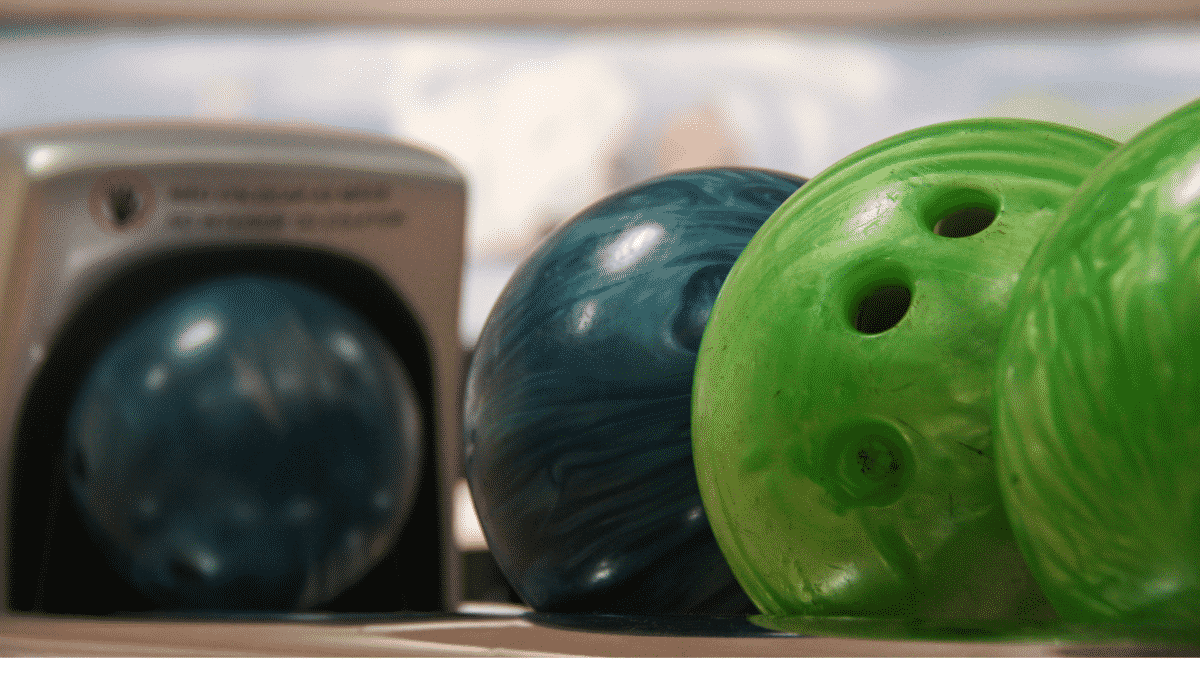 zoom of bowling balls in an alley