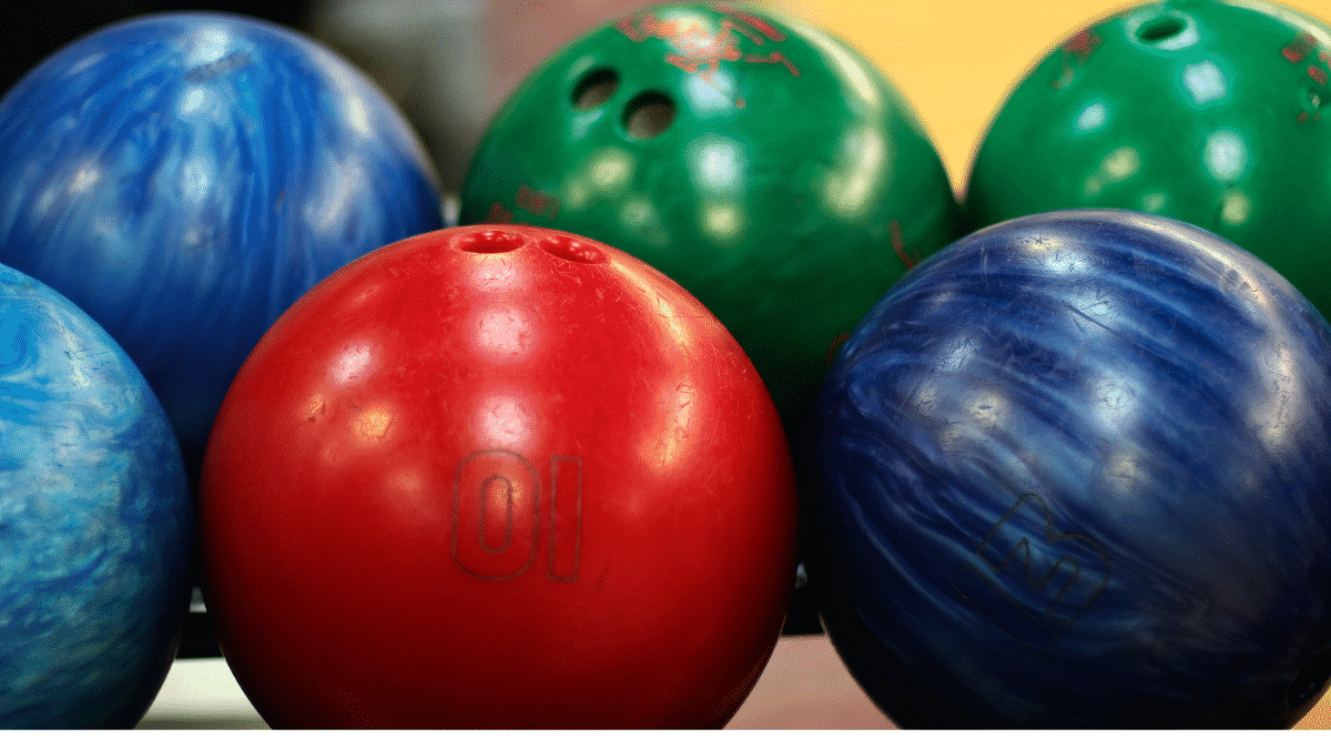 assorted colors of arranged bowling balls